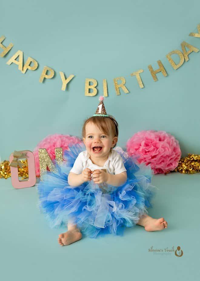 cake smash photography of beautiful baby girl